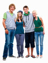 Teen young boys and girls standing together Stock Images