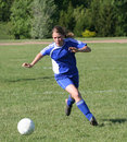 Teen Youth Soccer Player Chasing Ball Stock Photography