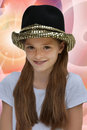 Teenage actress wearing a luxury hat with spangles Royalty Free Stock Photography