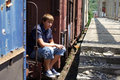 Teenage boy in abandoned train station Stock Photos