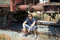 Teenage boy in abandoned train station Royalty Free Stock Image