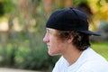 Teenage boy with acne and backwards baseball hat looking sideways Royalty Free Stock Photo