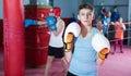 Teenage boy boxer in gloves posing during boxing