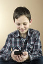 Teenage boy with cell phone Royalty Free Stock Images