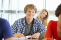 Teenage boy in class smiling to camera Royalty Free Stock Image