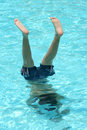 Teenage boy doing a handstand in a pool Royalty Free Stock Photos