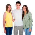 Teenage boy embracing teenage girls on white background Royalty Free Stock Image