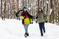 Teenage boy and girl running outdoor in winter park active family Royalty Free Stock Image