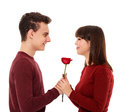 Teenage boy giving a flower to his girlfriend Royalty Free Stock Photo