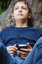 Teenage boy with GPS Royalty Free Stock Photo