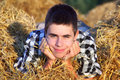 Teenage boy in the hay happy lying and dreaming Royalty Free Stock Photos