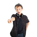 Teenage boy with headphones wearing a hat surprising face studio shot isolated on white background Stock Photos