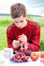 Teenage boy on his birthday lighting candles cake with number it Stock Photography