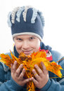 Teenage boy holds pile of colorful autumn leaves Royalty Free Stock Image
