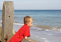 Teenage boy looking out the sea Royalty Free Stock Image