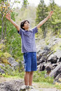 Teenage boy raising hands in praise Royalty Free Stock Photos