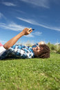 Teenage boy relaxing on phone Stock Photo