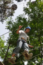 Teenage boy at the ropes course Stock Photography