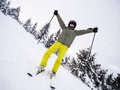 Teenage boy skiing winter sports Stock Image