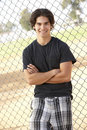 Teenage Boy Standing In Playground Royalty Free Stock Photo