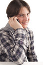 Teenage boy talking mobile phone isolated white background Stock Image