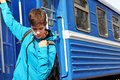 Teenage boy traveler getting off a train Stock Photo