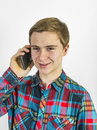 Teenage boy uses the mobile to talk to a friend Stock Photography