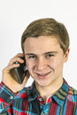 Teenage boy uses the mobile to talk to a friend Royalty Free Stock Images