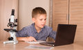 Teenage Boy Using Laptop At Home. School Boy with Laptop. Educat Royalty Free Stock Photo