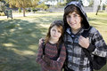 Teenage boy and young sister with school backpacks Royalty Free Stock Image