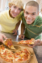 Teenage Boys Eating Pizza Royalty Free Stock Photo