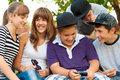 Teenage boys and girls having fun outdoor