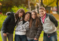 Teenage boys and girls having fun in the park Stock Photo