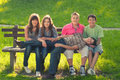 Teenage boys and girls having fun in the park in spring Royalty Free Stock Photo