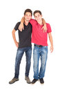 Teenage brothers happy hugging isolated in white Stock Photo