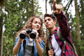 Teenage couple hiking in forest. Summer vacation. Royalty Free Stock Photo