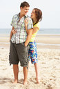 Teenage Couple Embracing On Beach Stock Images