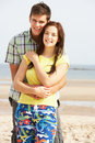 Teenage Couple Embracing On Beach Stock Photography