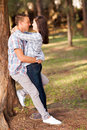 Teenage couple embracing romantic outdoors Royalty Free Stock Images