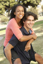 Teenage Couple Having Fun In Playground Royalty Free Stock Photography