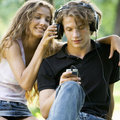 A teenage couple listening to music Royalty Free Stock Photo