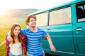 Teenage couple in love outside in nature green campervan young boy and girl boyfriend and girlfriend running old Stock Image