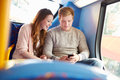Teenage couple reading text message on bus whilst sitting down Royalty Free Stock Images