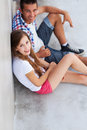 Teenage couple sitting Royalty Free Stock Photo