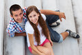 Teenage couple sitting on stairs Stock Photo