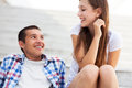 Teenage couple sitting on stairs Royalty Free Stock Photo