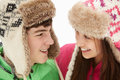 Teenage Couple In Snow Wearing Fur Hats Royalty Free Stock Image