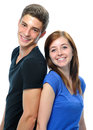 Teenage couple standing back to back Royalty Free Stock Photo