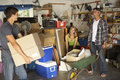 Teenage Family Clearing Garage For Yard Sale Royalty Free Stock Photo