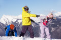 Teenage Family Having Snow Fight In Mountains Royalty Free Stock Images